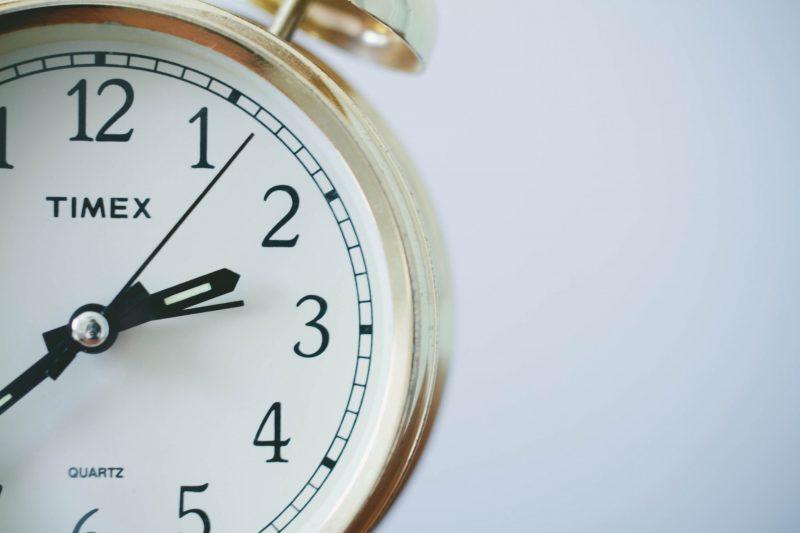yellow Timex alarm clock