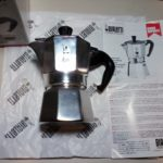 moka pot laying on its side camera photo shot