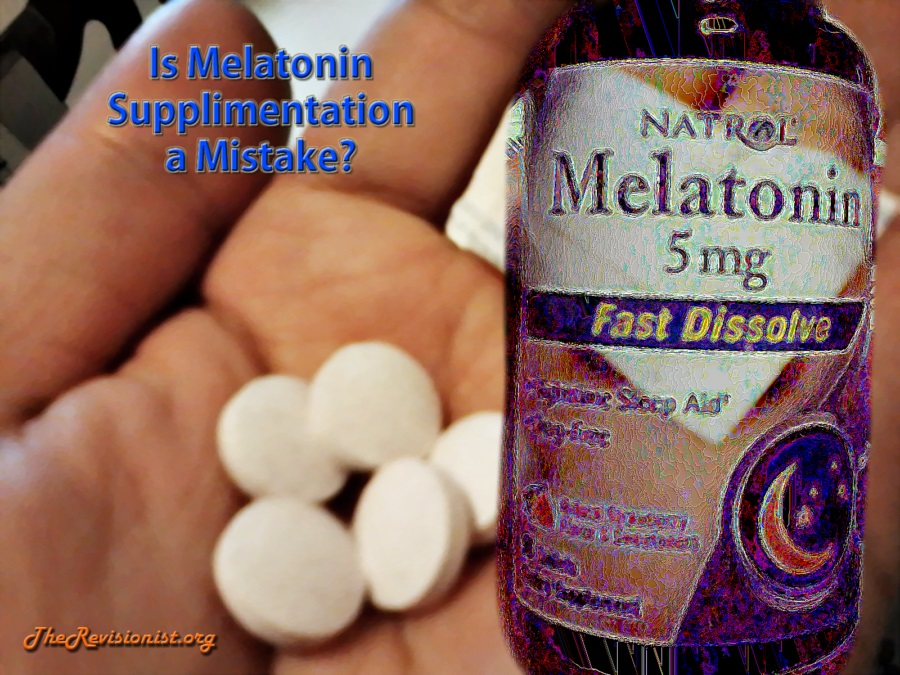 hand holding melatonin tablets
