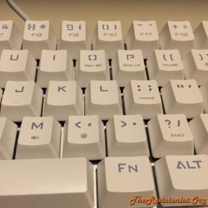 68 Keys Mini Magicforce mechanical keyboard showing english alphabet keycaps