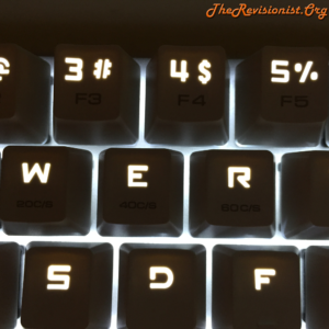 68 Keys Mini Magicforce mechanical keyboard in the dark glowing LED Keycaps
