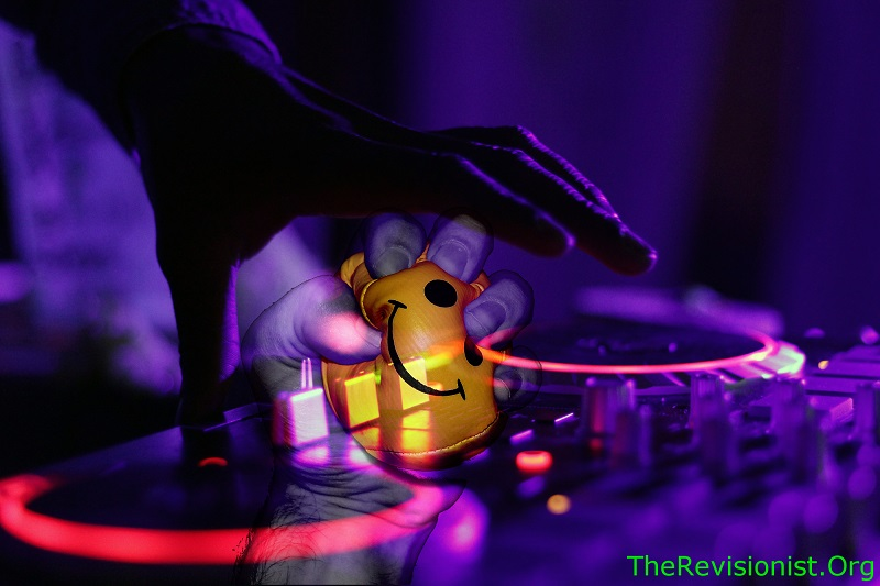 dj mixing music with transparency of hand squeezing stress ball