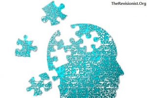 silhouette of human head breaking apart as puzzle pieces symbolize alzheimers and dementia loss of cognitive function