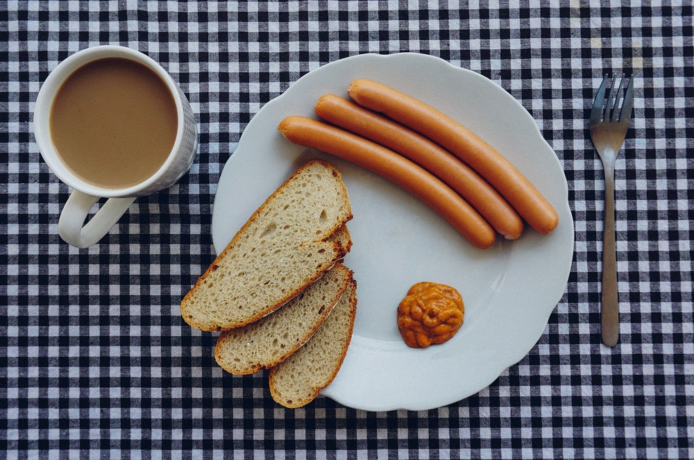 coffee hotdog bread slices weird sauce fork ready to eat breakfast photo