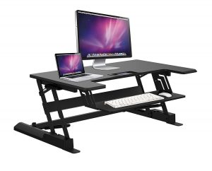 desk riser with example laptop and monitor and keyboard and mouse apple type