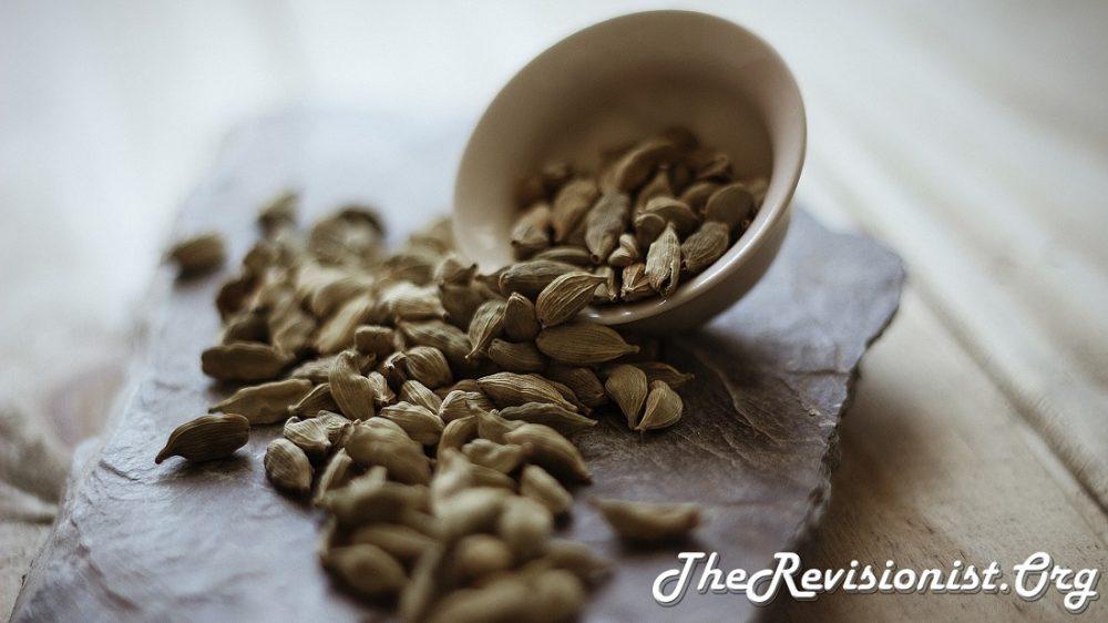 Cardamom seed pods spilled